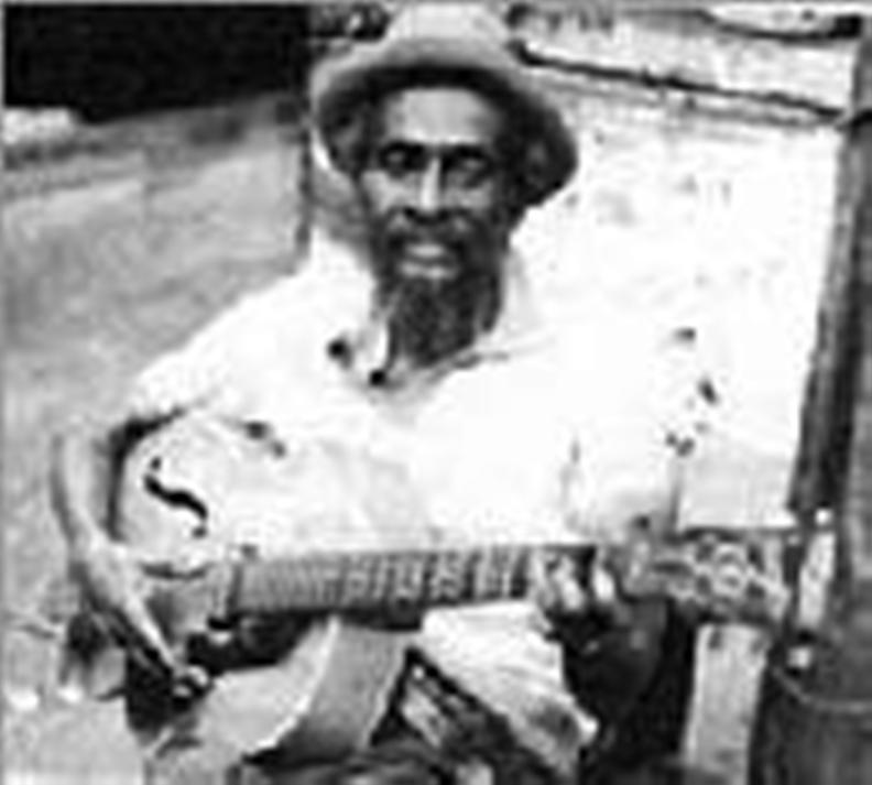 Jah Jerry Haynes  musing with guitar